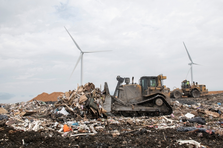 A bulldozer pushing piles of waste at the Frey Farm Landfill
