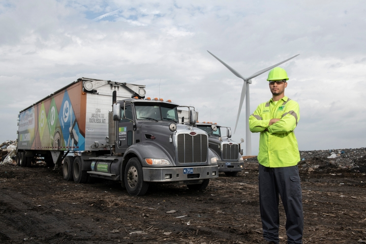 A LCSWMA worker standing in front of a truck at the Frey Farm Landfill